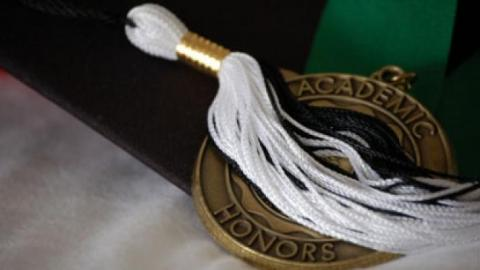 Tassel lying over an awards medal.