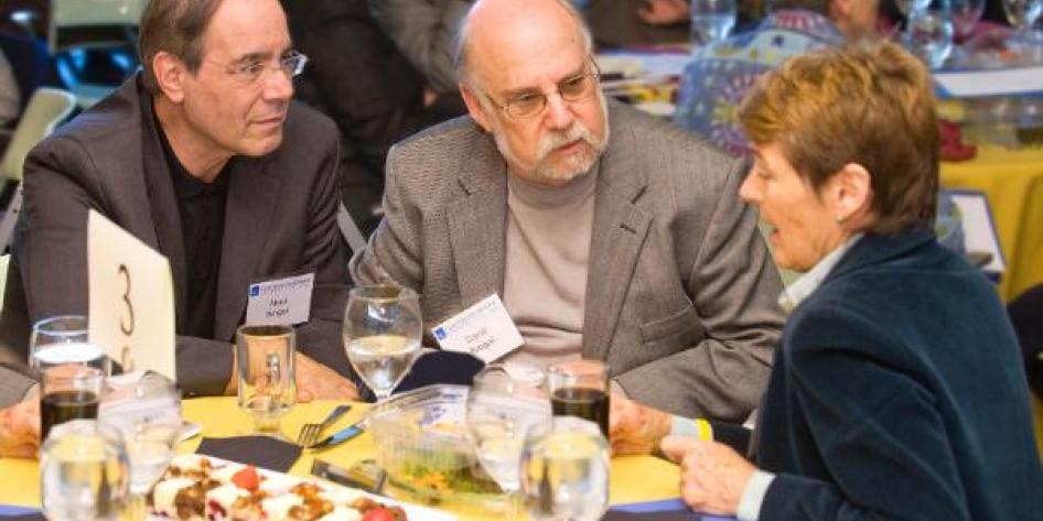 Three Case Western Reserve University leaders conversing at 2010 Provost Retreat