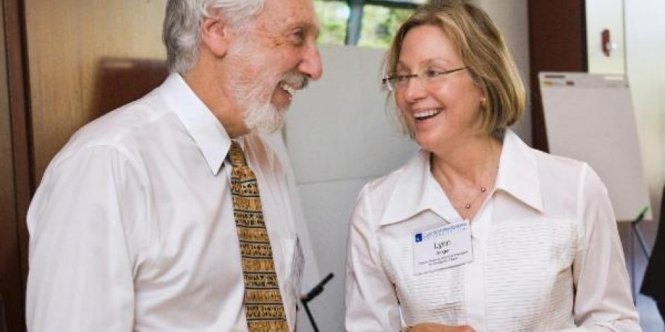 Two Case Western Reserve University leaders laughing at 2011 Provost Retreat
