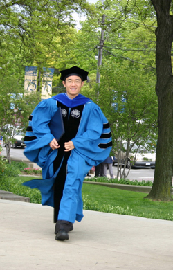 A graduate arrives on campus for his Commencement ceremony.