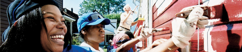 Volunteers from Case Western Reserve University paint a house on Case for Community Day.