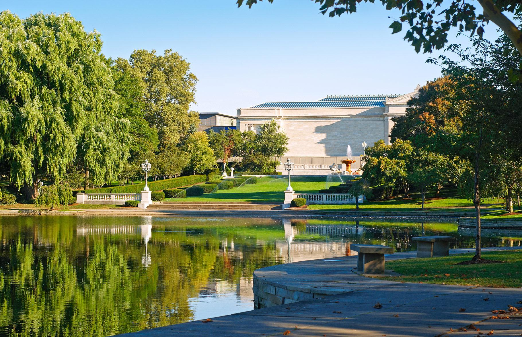 A view of the front of the Cleveland Museum of Art with the pond in front