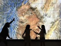 Children interacting with the art installation touch screen