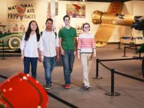 A group of four students walking through the Cleveland History Center Auto Aviation Museum
