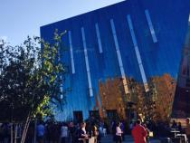 Exterior view of MOCA with people walking by