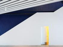 Interior view of the angles on the walls with a navy accent color on one wall