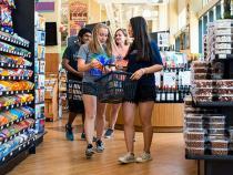 Students grocery shopping at Constantino's