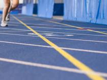 Student running on the track in Veale