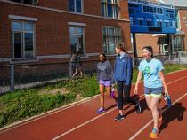 Students walking on the track at Wyant