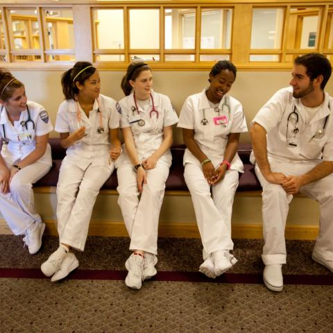 CWRU student nurses talking to each other