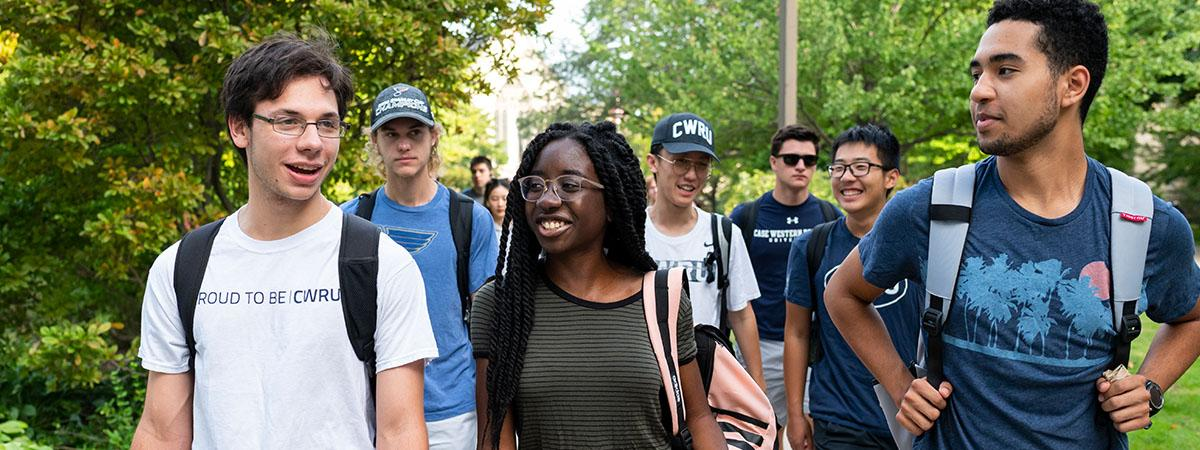 Groups of students walk across campus at Case Western Reserve University