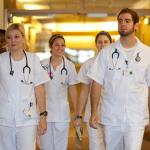 CWRU nursing students walking in scrubs