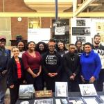 Members of the Black Student Union pose with memorabilia from the Black History 101 Mobile Museum