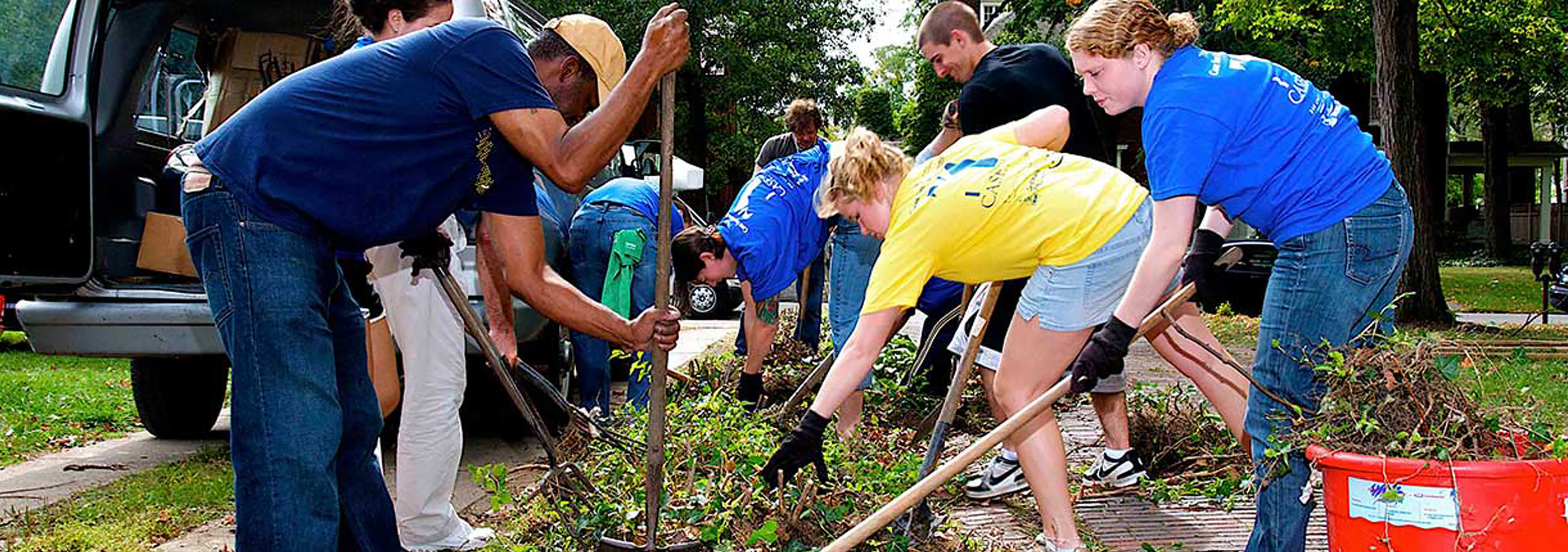 Student volunteers working on a garden