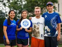 Ultimate Frisbee club posing with a frisbee after practice