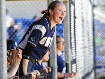 Softball team cheering on a player