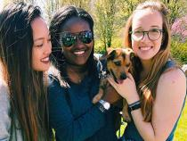 Sorority sisters holding a puppy