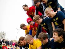 Fraternity brothers building a human pyramid