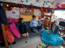Students sitting in their dorm room hanging out