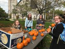 Random acts of kindness club giving away pumpkins