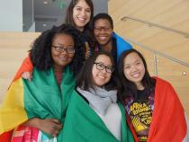Case African Student Association posing for a photo with their countries flags