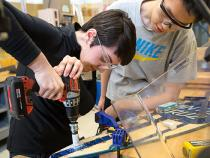 Students using power tools in the thinkbox