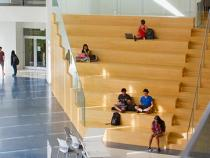 Students sitting on the stairs in the Tink