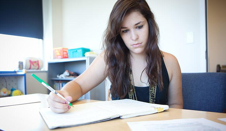 Student working on a report during an internship