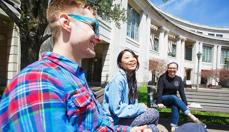Students sitting outside of the Kelvin Smith Library
