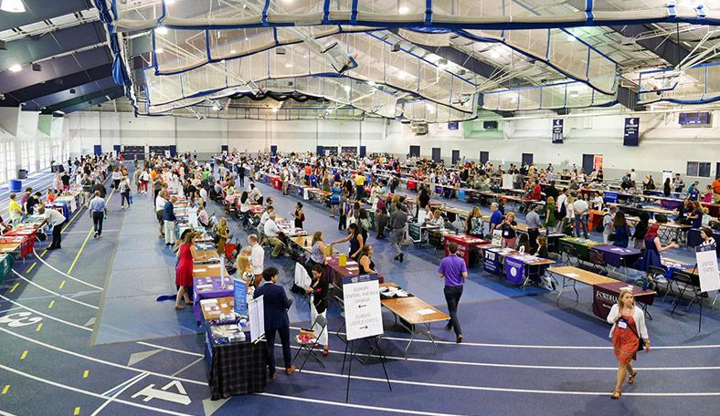 A college fair being held at a gym