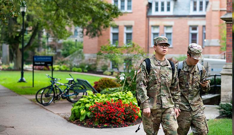 US Army Recruits standing on campus.