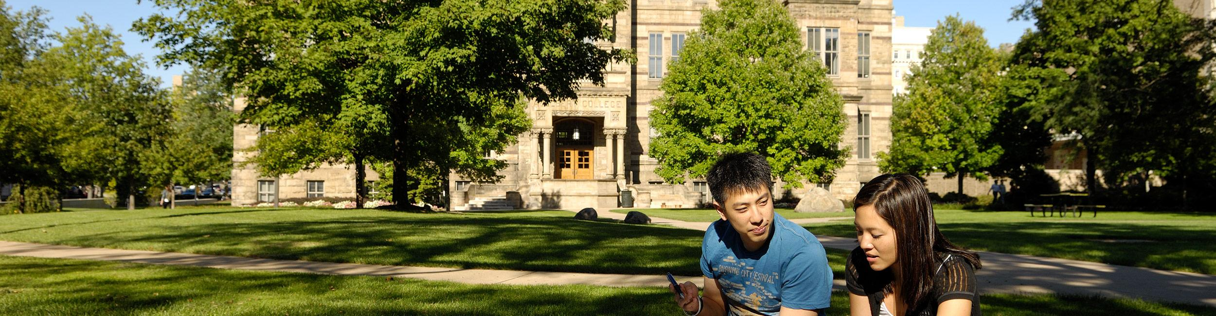 Students sitting on the grass in the quad