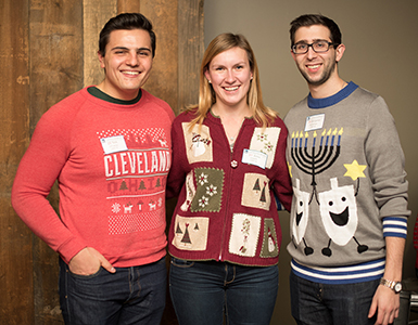 image of alumni in holiday sweaters