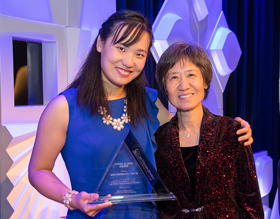CWRU Alumna Veronica Xu poses with her mother and The Alumni Association's 2017 Young Alumni Award during Homecoming 2017.