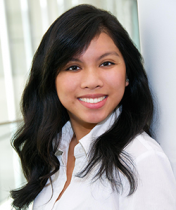 Headshot of Elisse Cortez, posed and smiling for the camera