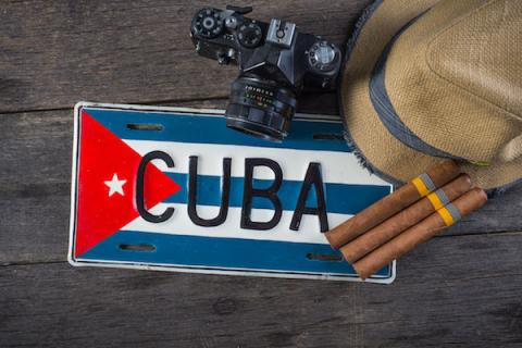 image of Cuba license plate, cigars, hat and camera