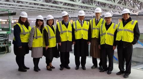 A delegation from the Taipei Medical University tours the construction site of CWRU's Health Education Campus.