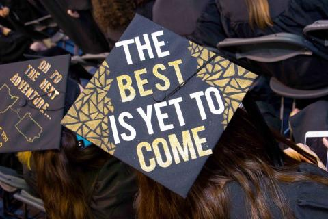 Graduation cap with message on top - The Best is Yet To Come