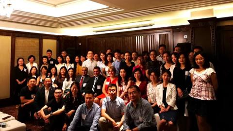 Group of CWRU students in Shanghai, smiling and posed for the camera with Dean Malhotra from Weatherhead