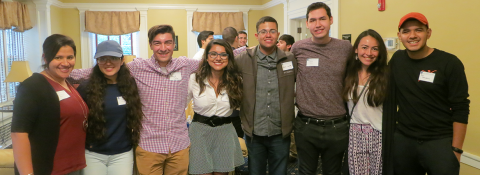 Photo of CWRU students, standing arm in arm, posed and smiling for the camera at the 2017 Latino Alumni Network and La Alianza Student Networking event