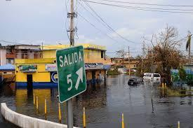 A flooded street of Puerto Rico following a hurricane.