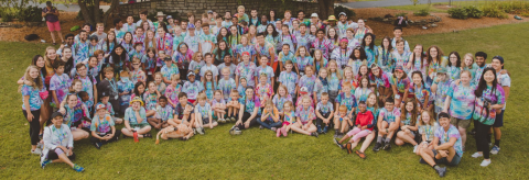 A group shot of the campers and volunteers of Camp Kesem, a free camp for children whose parents have been affected by cancer.