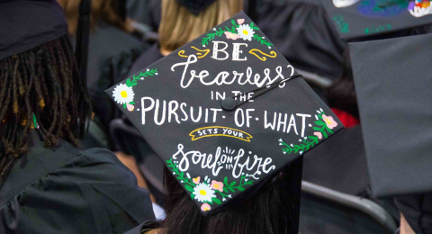 "Decorated graduation cap at CWRU Commencement that says ""Be Fearless in the Pursuit of what sets your soul on fire"""