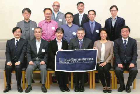 A group of CWRU Alumni in Japan are photographed at their annual dinner