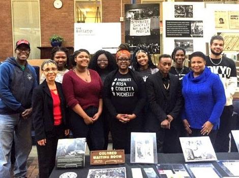 African American Alumni Association members pose with a display contributed to the Mobile Black History Museum that visited the CWRU campus.