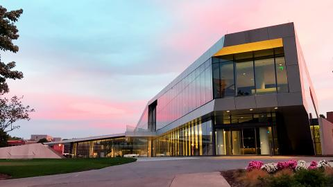 Exterior of the Tinkham Veale University Center at sunset