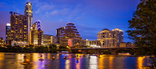 Skyline of the city of Austin, lit up at dusk