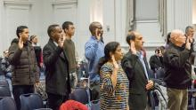 A group of people take the oath of citizenship to the United States