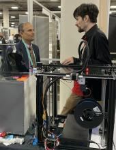 "Venkataramanan ""Ragu"" Balakrishnan, Charles H. Phipps Dean, Case School of Engineering, meets with a CWRU student on the floor of CES 2020."