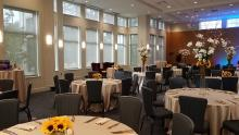 A photo of the Foster-Castele Great Hall at the Linsalata Alumni Center, full of tables set for a wedding reception